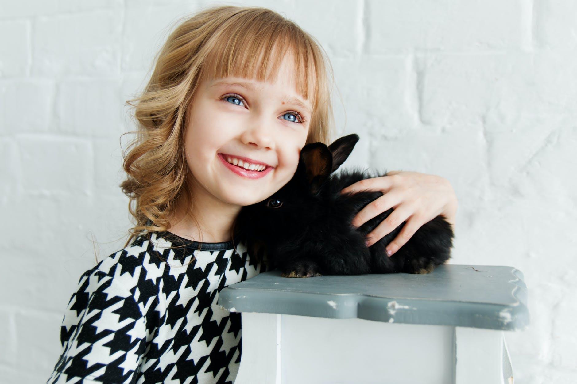 girl holding black rabbit