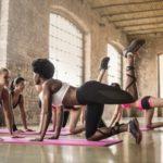 women doing yoga class on pink yoga mat