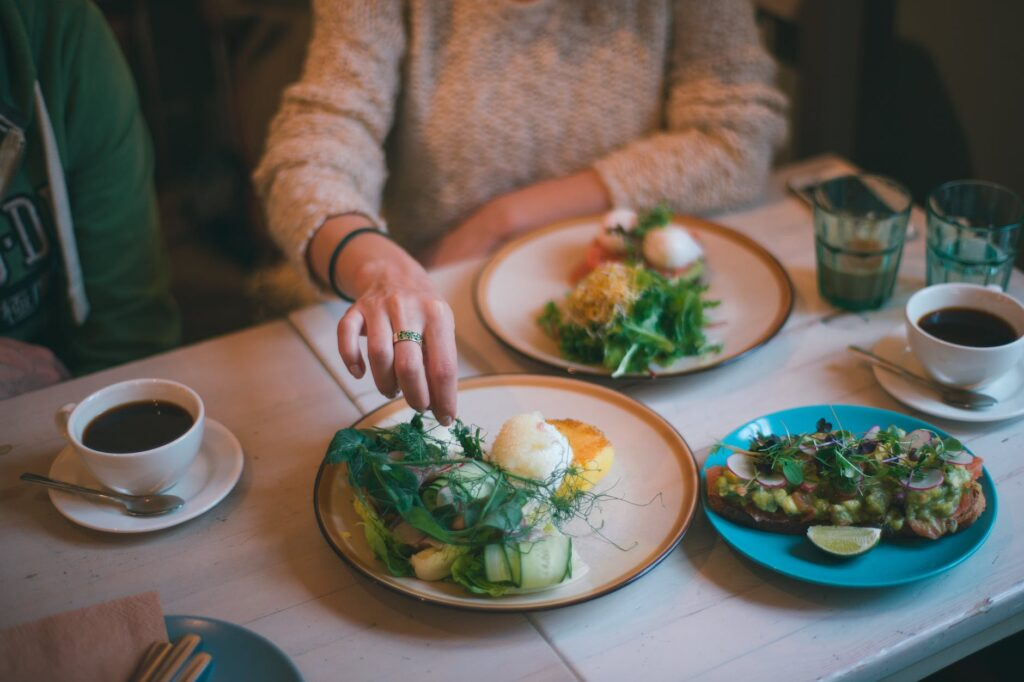 woman having meal with healthy food and strong coffee