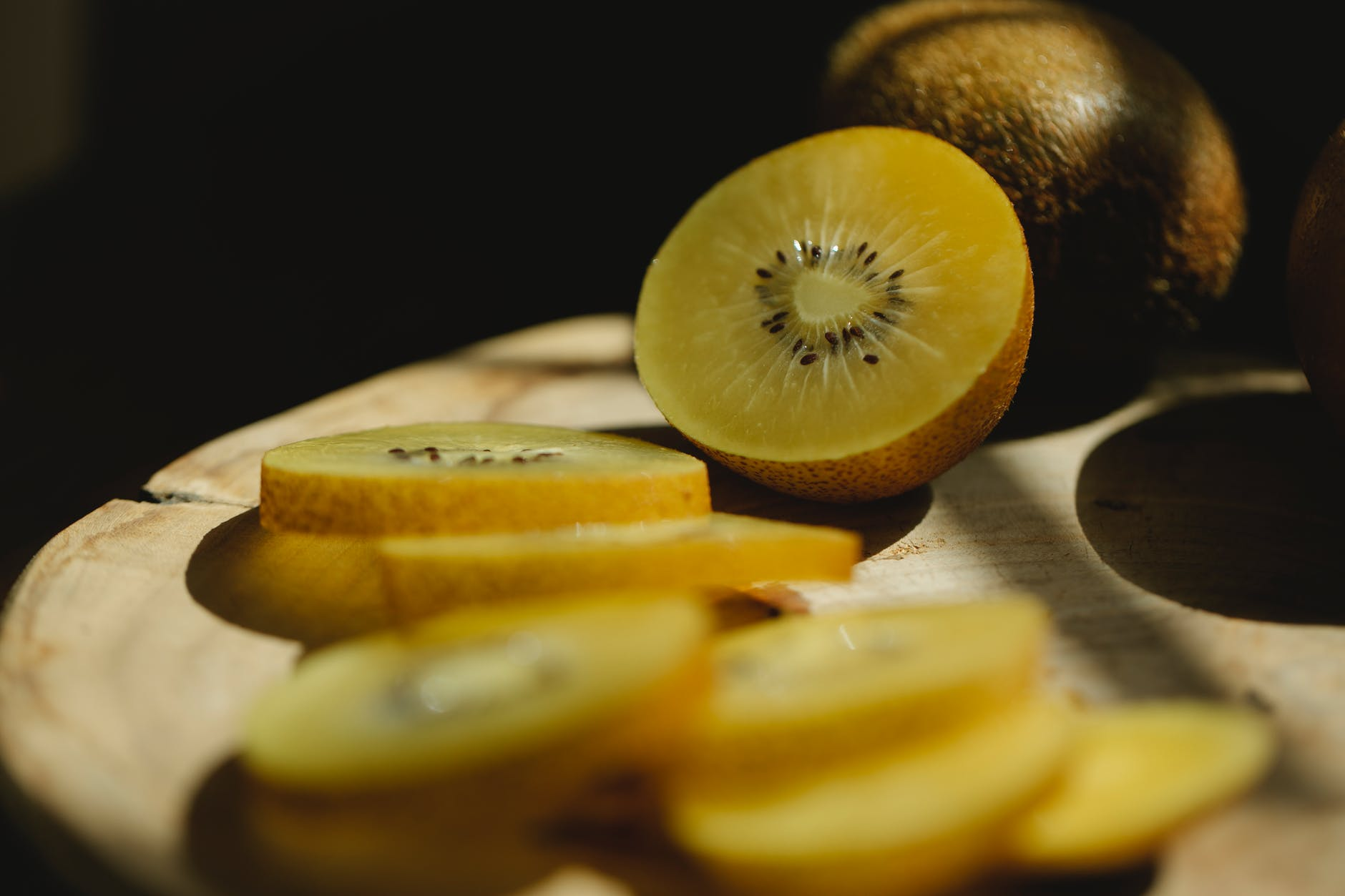sliced kiwi with juicy pulp on table