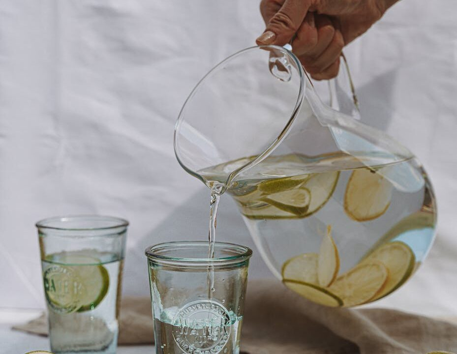 glass jug with water and lime
