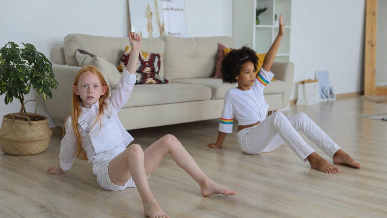 adorable diverse girls training together on floor
