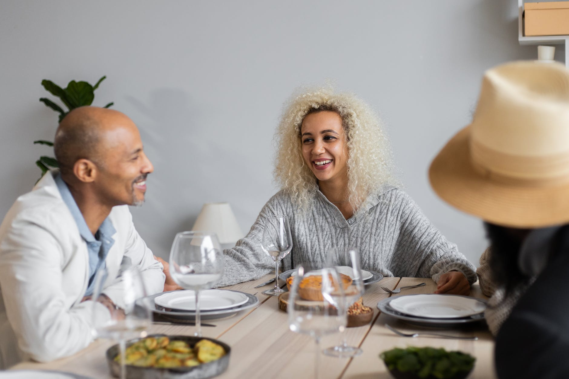 smiling people at table with food
