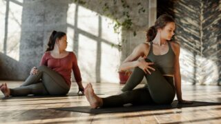 photo of women stretching together