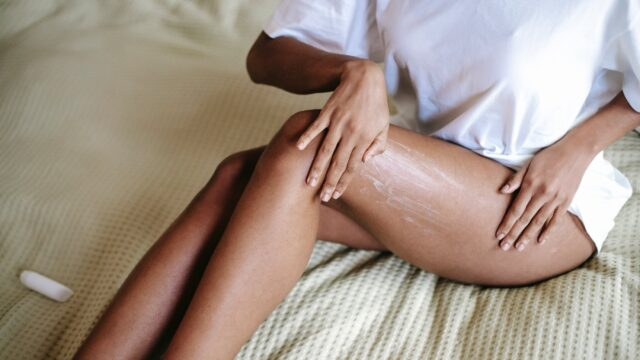 woman doing leg massage with cream